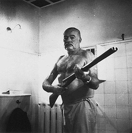 Ernest-Hemingway-with-a-rifle